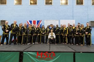 Grand Master Choi with Mark Lloyd and other Instructors receiving special thank you for helping promote CKD in UK