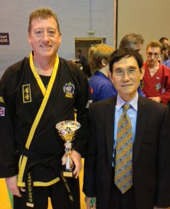 Mark Lloyd with Grand Master Kwang Jo Choi receiving trophy in UK Choi Kwang Do Showcase of Excellence